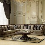 spacious and luxurious living room idea with queen anne couch design with L shape and plenty of cushions and wooden rectangle table with patterned area rug and large glass window