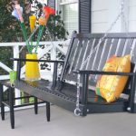 stunning black porch swing set with golden yellow cushion aside black small table with yellow vas