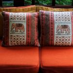 stunning elephant print on rustic cushion with ethnic pattern on orange modern sofa design