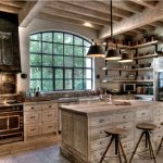 stunning rustic kitchen design with wooden cabinet and island full of drawers and wooden stools and pendant and glass window