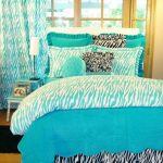 stunning turquoise bedding idea with zebra patterned accent and stunning fresh curtain wih wooden framed glass window and wooden floor