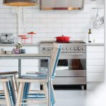 stunning white kitchen ith adorable retro dining table wih white blue chairs and light gray table with black orange pendant