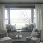 stunning white slipcovered bay window couch design with small round coffee table and white banquette and white curtain