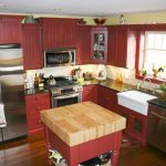 super adorable red country kitchen design with small island with natural wooden top and small glass window and creamy backsplash