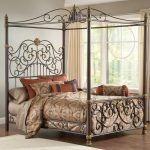 super awesome iron canopy bed frame with luxury comforter set plus modern drapes on windows plus white rug on wooden laminate floor