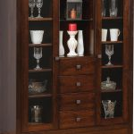 tall china cabinet in dark finished with two glass doors and four drawers completed with elegant dish collection