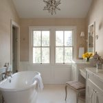 traditional bathroom ideas with moravian star pendant light fixture and ceramic bathtub plus wooden bathroom vanity unit plus mirror mounted on wall and wall scones