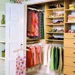 tropical dressing room design with beautiful floral decoration and wooden storage and wooden floor