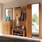tropical wooden hall storage with bench with shoe storage and clothes hooksboard and vanity with wall mirror and mirrored cupboard