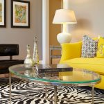 unique and colorful living room design with bright yellow sofa idea and colorful cushion and zebra area rug and black chair and floor lamp and wall picture