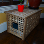 unique cat litter box ideas made of wood decoraded on the corner of the room together with pots and solid dark flooring