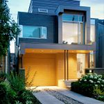 unique designed two storey house design with contemporary style and yellow facade with gray combination