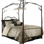 unique iron canopy bed frame with patterned bedding set and comfy black pillows