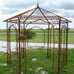 unique wrought iron pergola with windows and doors in attractive design plus green grass field