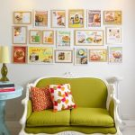 vintage fresh green sofa design in the kitchen with white carved frame aside round white table beneath wall pictures and light track