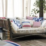 vintage sofa idea with creamy patterned upholster and colorful rustic cushion idea and rustic wooden flooring
