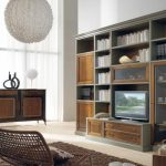 vintage wooden bookcase design in the living room with sliding glass accent adn rattan chair and brown area rug and ball pendants and glass window