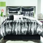 white and black cool comforter sets for modern bedroom ideas for teenage plus round side table and green table lamp plus grey wooden floor