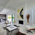 white lounge chairs for living room in midcentury room with white loveseat plus unique rug and adorable kitchen and abstract pictures