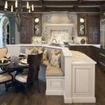 wonderful kitchen design with breakfast nook and banquette seating and chair and round wooden table and chandelier