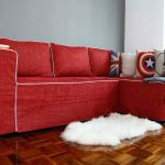 wonderful red slipcover sofa design with patterned cushions on bamboo flooring with white ikea sheepskin rug