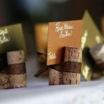 wooden-stick-placecard-with-brown-ribbon-to-tie-up-the-sticks-and-put-card-in-each-stick-with-person's-name