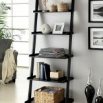 Beautiful Dark Wooden Ladder Shelving Unit On Grey Wall