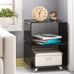 Black acylic side table with shelving units for books box storage and wheels