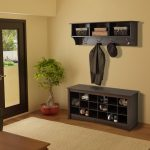 Black coated wood shoes storage with bench in entryway area wall mounted shelf with hangers in black