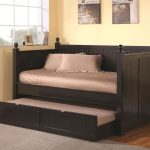 Black painted wood daybed withs trundle addition by IKEA for guest