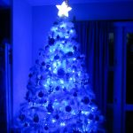 Blue And White Christmas Lights On Tree With Star