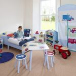 Blue  themed modern toddler bed idea with side table storage for toys and book storage a set of desk with two round top chairs