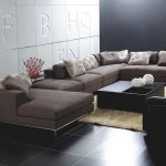 Brown Unique Sectional Sofas With Pillows And Rectangular Of Coffee Table