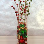 Colorful Christmas balls as the transparent glass vase filler