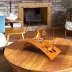Cool and modern indoor fire pit center table made of solid wood in round shape