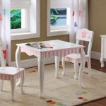 Cute wood table and chairs in classic style for little girls flower patterned white lace window curtain white area rug with colorful decoration