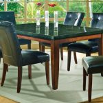 Dark Black Granite Dining Table Set And White Rug
