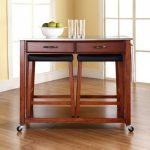 Dark brown coated wood kitchen cart with wheels glass top drawers and a pair of bar stools