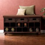 Dark wood shoes storage system with cushioned bench for entryway