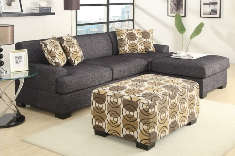 Deep Grey Apartment Sized Sectional Model With Chaise And Accent Pillows An Ottoman Table Modern