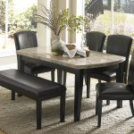 Elegant Granite Dining Table Set With Black Chairs And Fur Rug