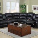Elegant black leather sectional with reclining feature wooden coffee table with storage underneath
