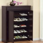 Entryway shoes rack made of wood in black finish