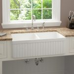 Farm styled kitchen sink and faucet brown granite countertop
