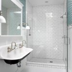 Floating Kohler Sink With A Pair Of Faucets For A Modern Bathroom A Frameless Mirror A Pair Of Vanity Lamps Frameless Glass Door Shower Space With Wall Mounted Showerhead Fixture