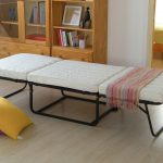 Folded guest bed IKEA with white cushion