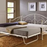 Large daybed frame made of metal brown shaggy area rug