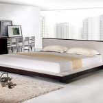 Low Platform Of Modern King Size Bed Frame With Fur Rug