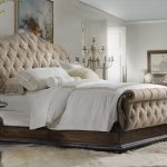 Luxury Tall Upholstered Bed And Cool White Bedding Plus Fur Rug