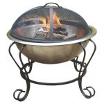 Metal fire pit with enclosure and wrought iron stands